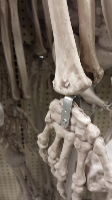 The Garden Ridge skeletons have metal hardware for 2014.  Hopefully this makes them sturdier.