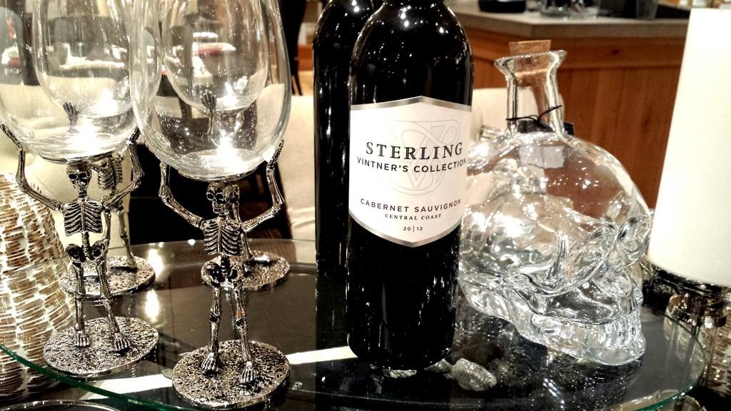 Skeleton wine glasses and skull bottle
